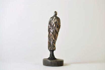 Mandefigur i bronze - set bagfra