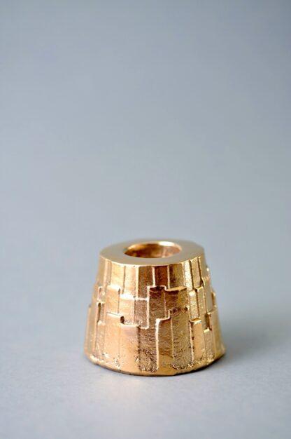 Metropolis-Lysestage-i-bronze